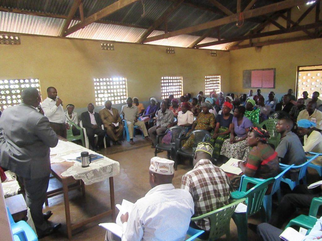 Member Wafula Sirabo Patrobas addressing participants at the dialogue in Kiryandongo