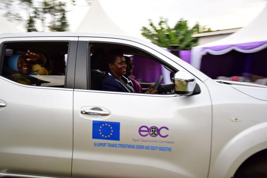 The chairperson EOC Sylvia Muwebwa Ntambi drives Hon Janat Balunzi Mukwaya, Hon Asamo Hellen and Mr Anthony Kintu Mwanje in one of the six cars given to the commission.
